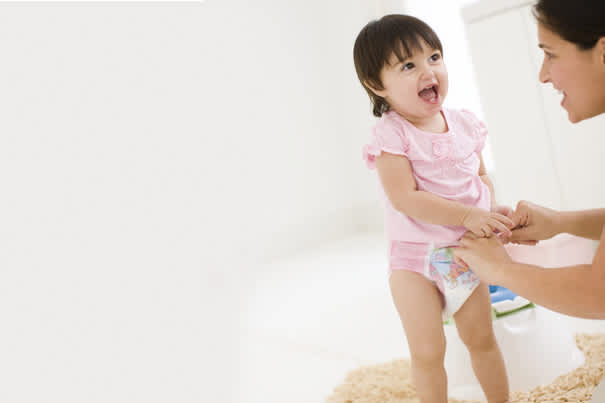 5. After she's comfortable with that, have her sit on the potty with clothes off.