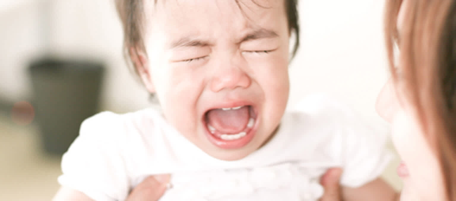Colic in babies: baby crying, suffering colicky pain