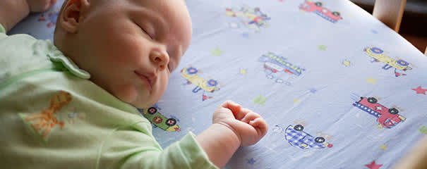 Baby sleeping on their back to reduce risk of SIDS