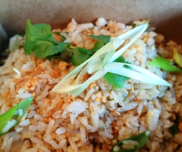 Egg fried rice with spring onion, topped with crispy garlic