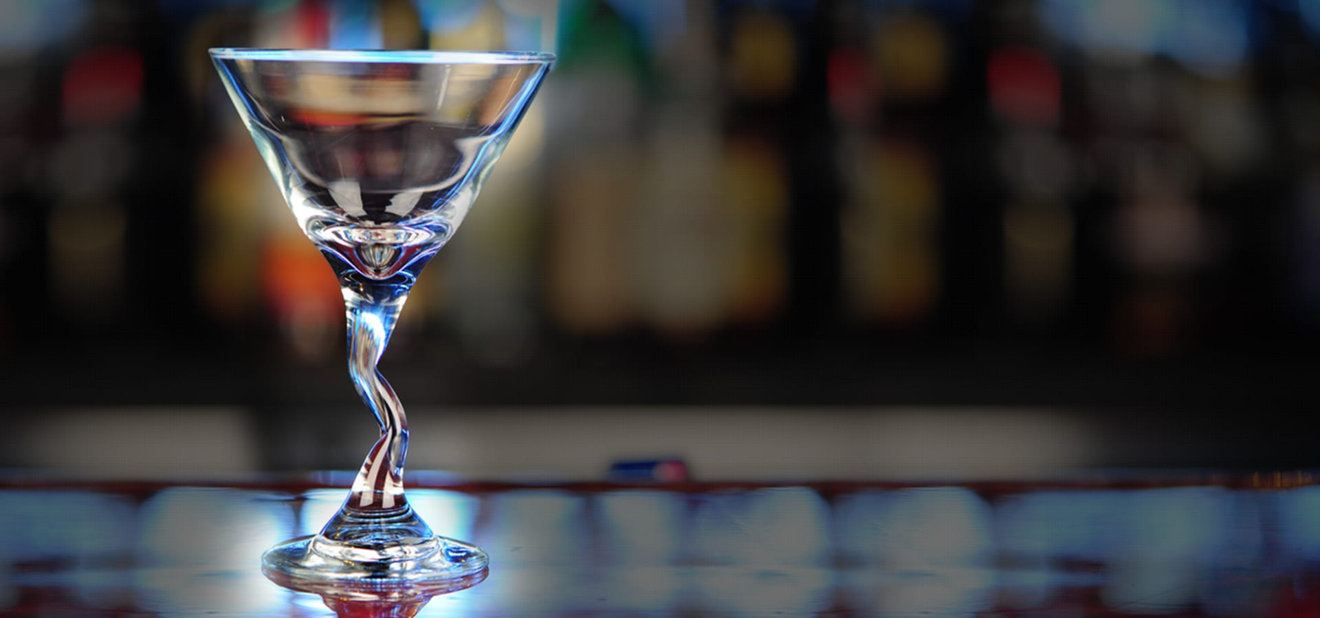 martini glass on bar