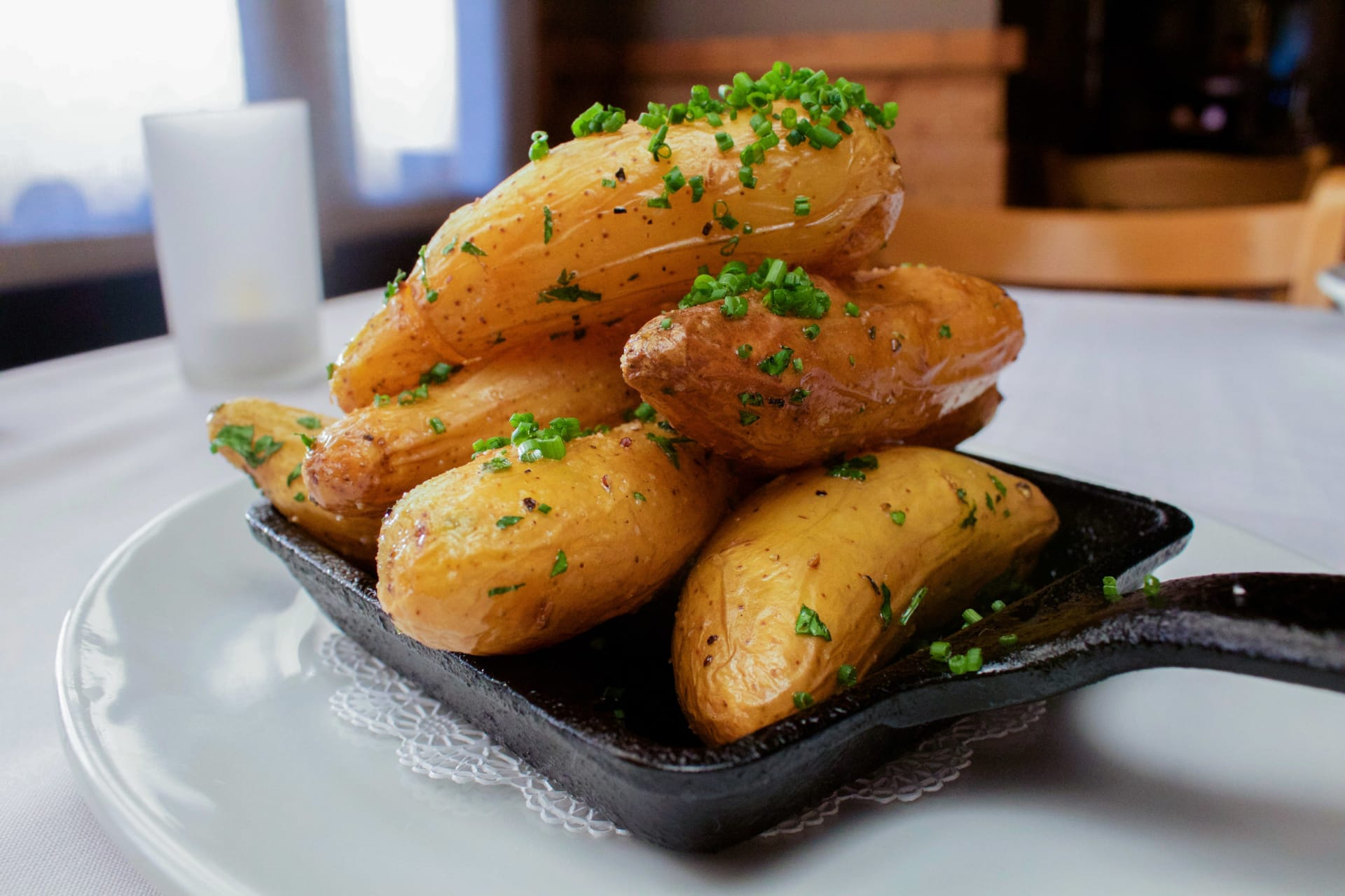 Close up side view of a dish of potatoes