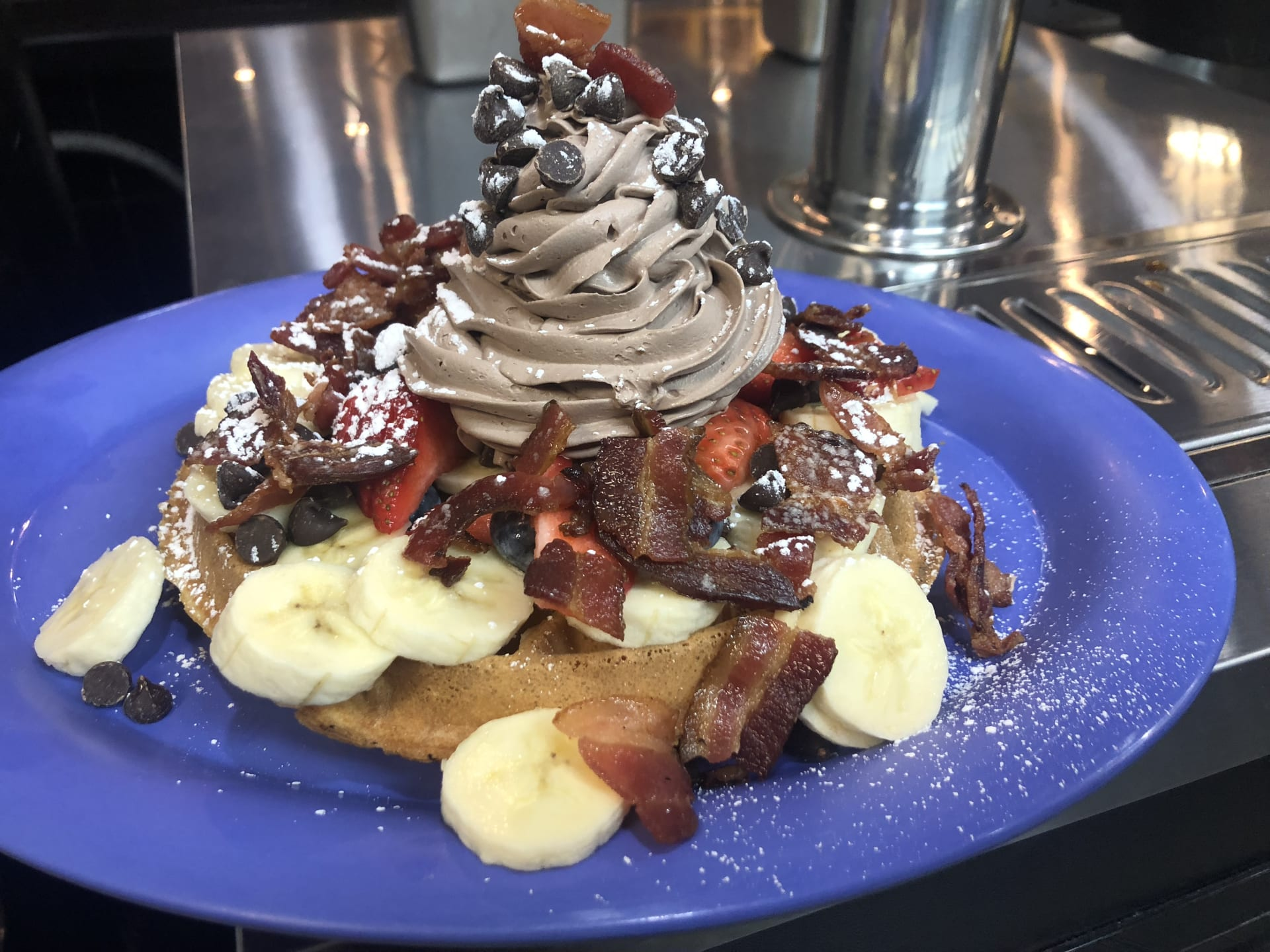 "Chocolate Chip & Bacon Waffle topped with ""USA"" Fruit"