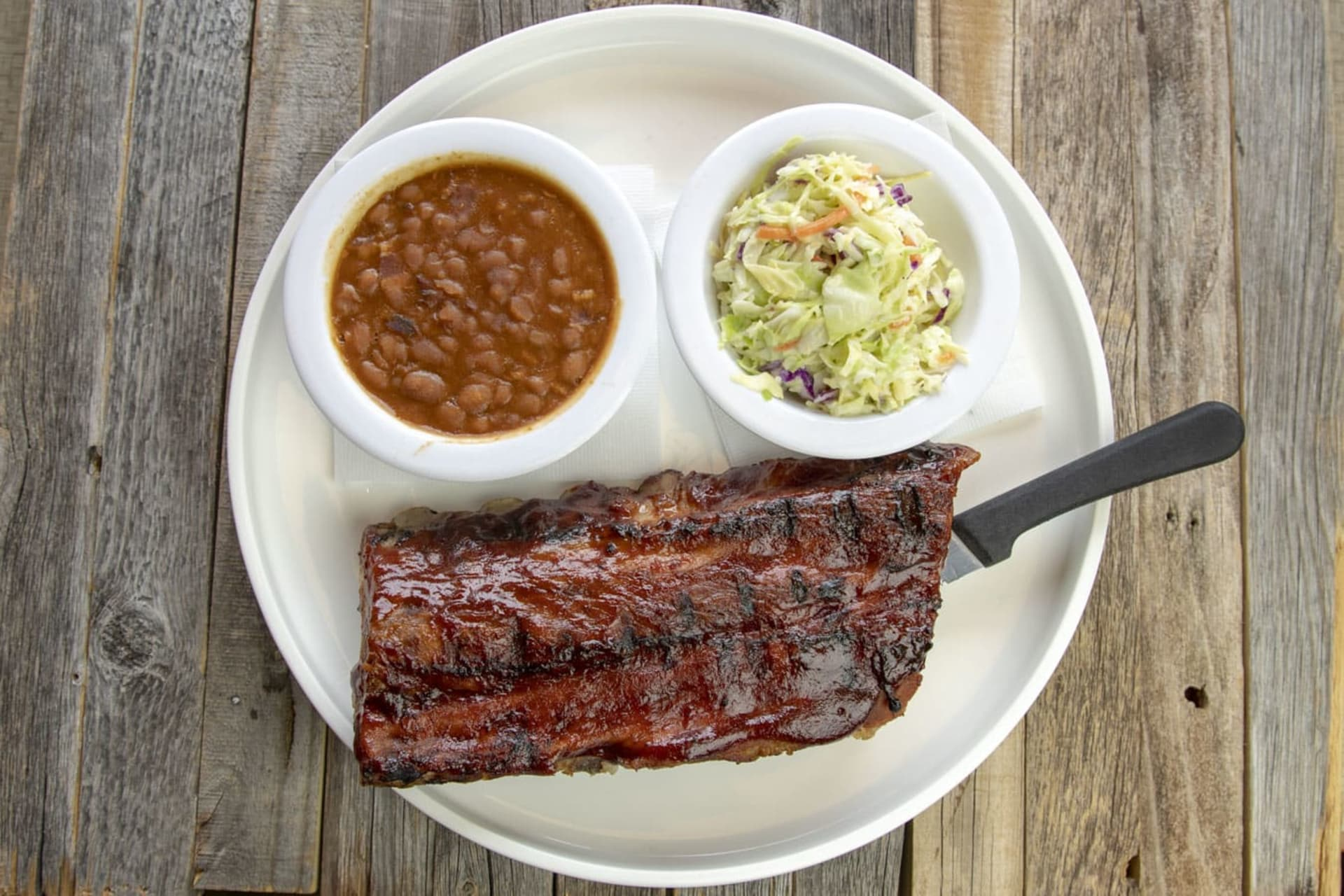 rack of ribs, beans and coleslaw