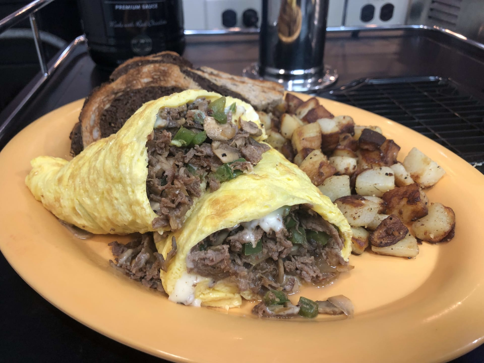 Delicious omelette with homefries