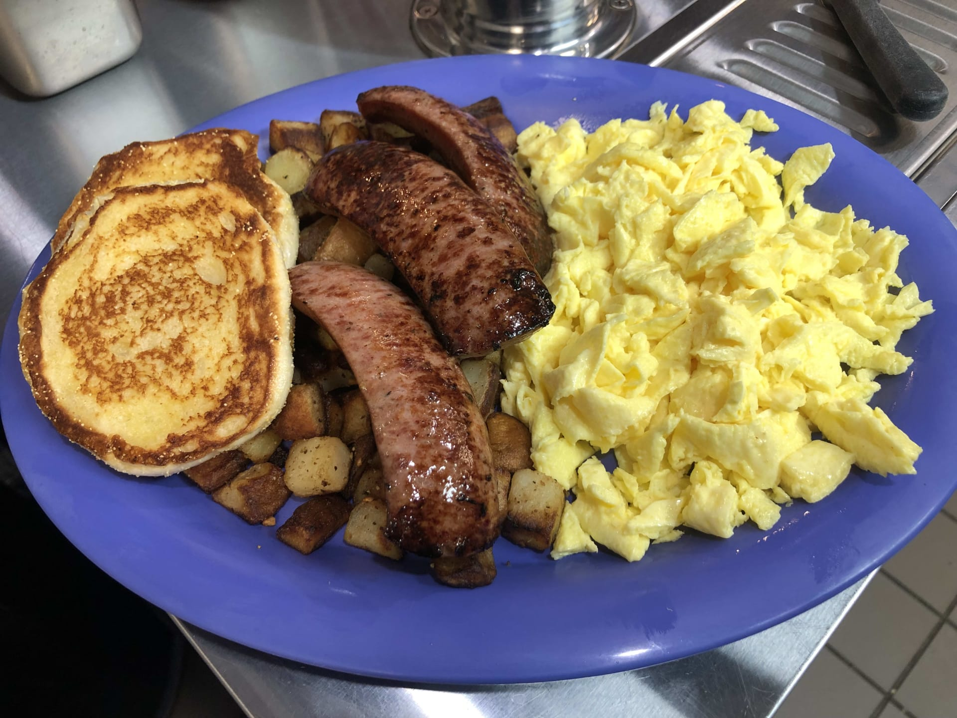 steak eggs and a side of pancakes