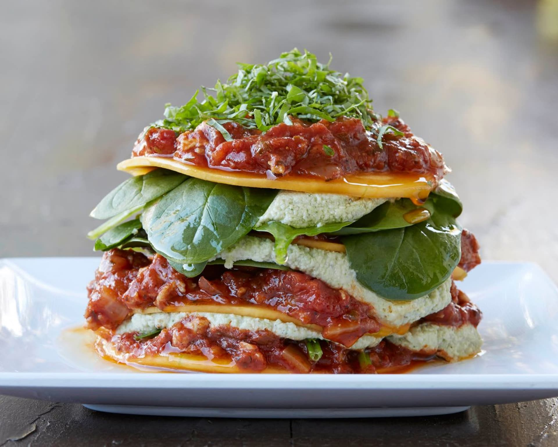 stacked food with herbs and sauce