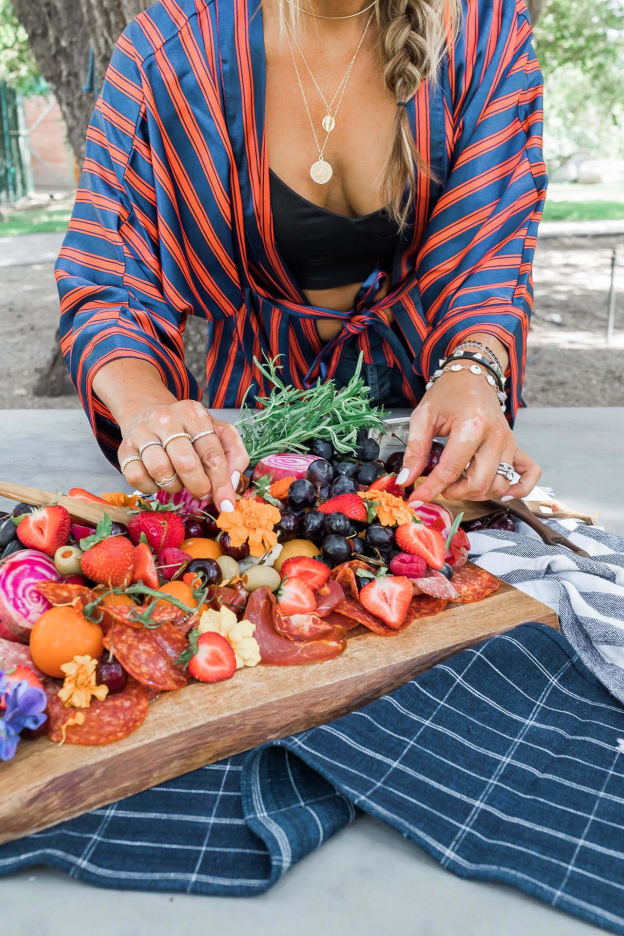woman arranging fruits & veggies