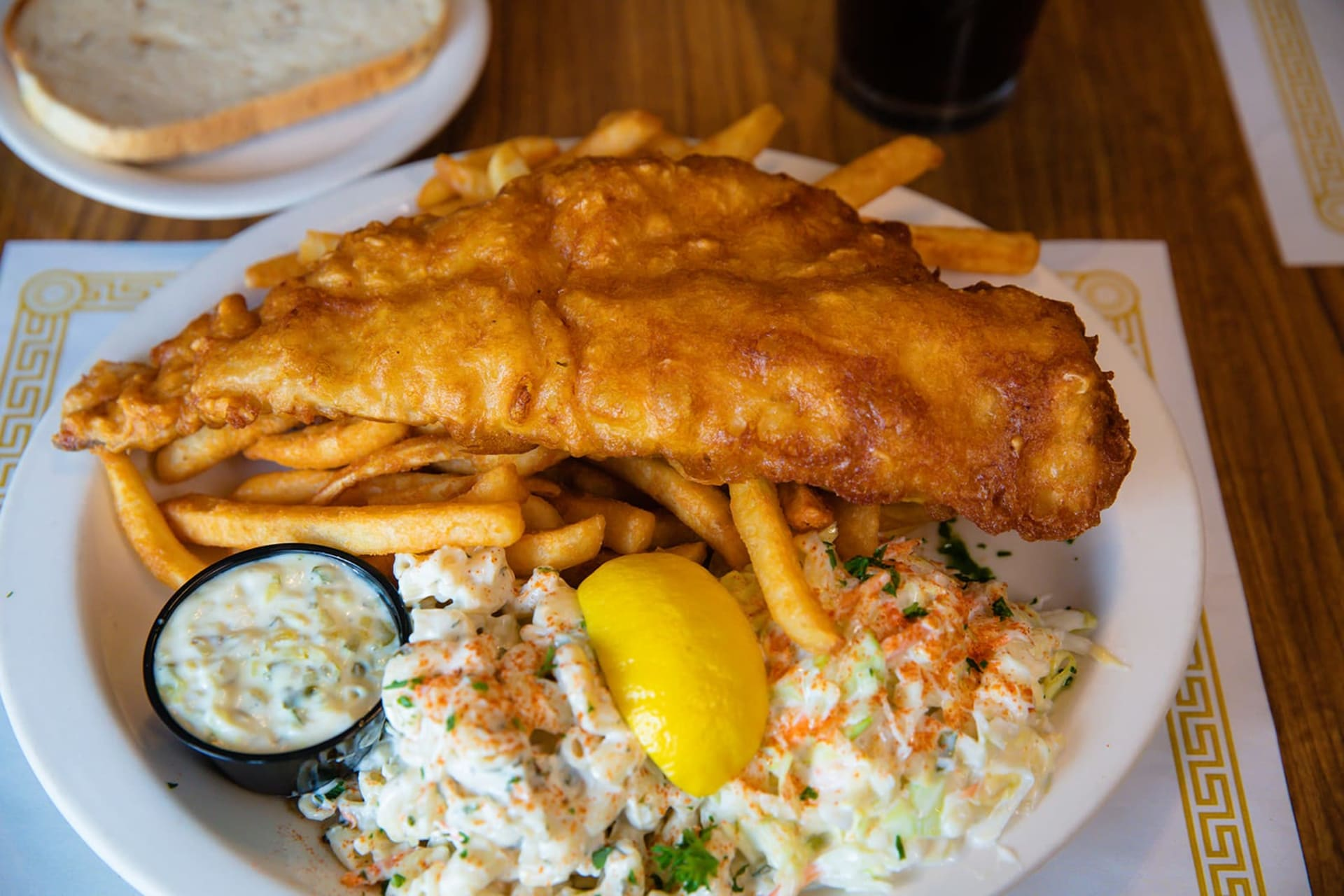 fried fish with french fries and salad