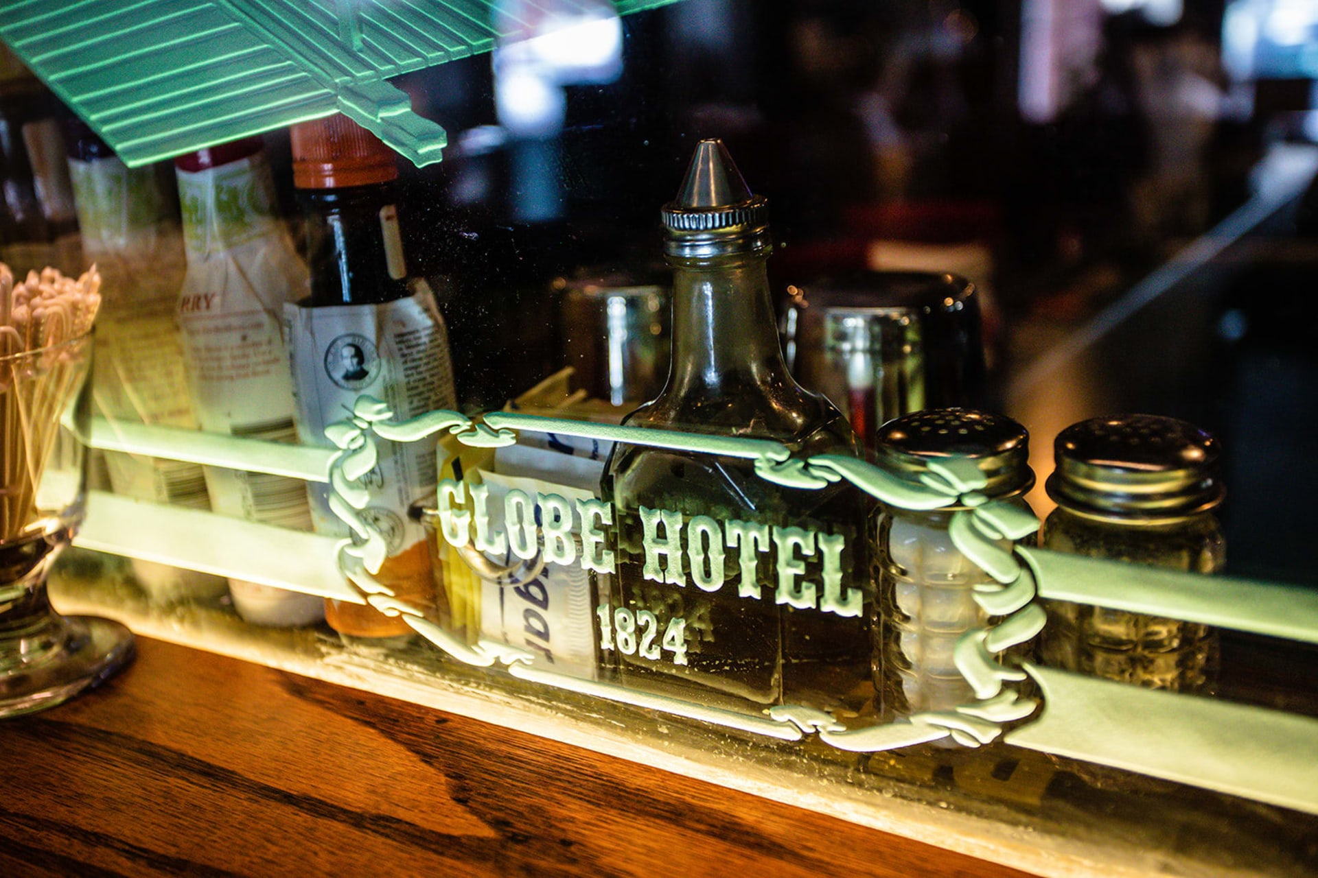 globe hotel window sign