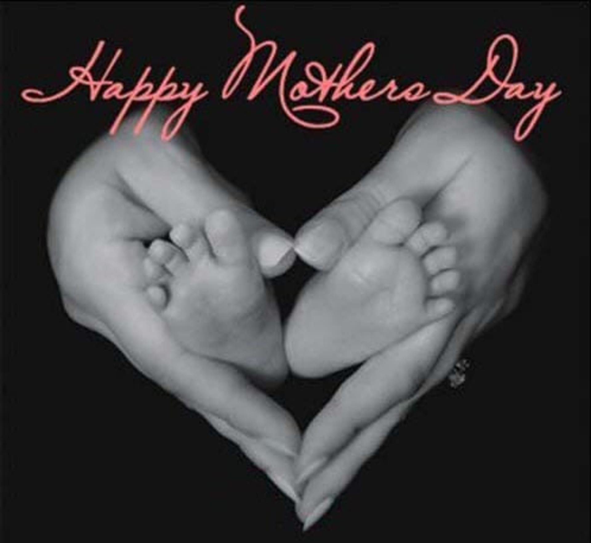 happy mother's day baby's feet in mother's hands