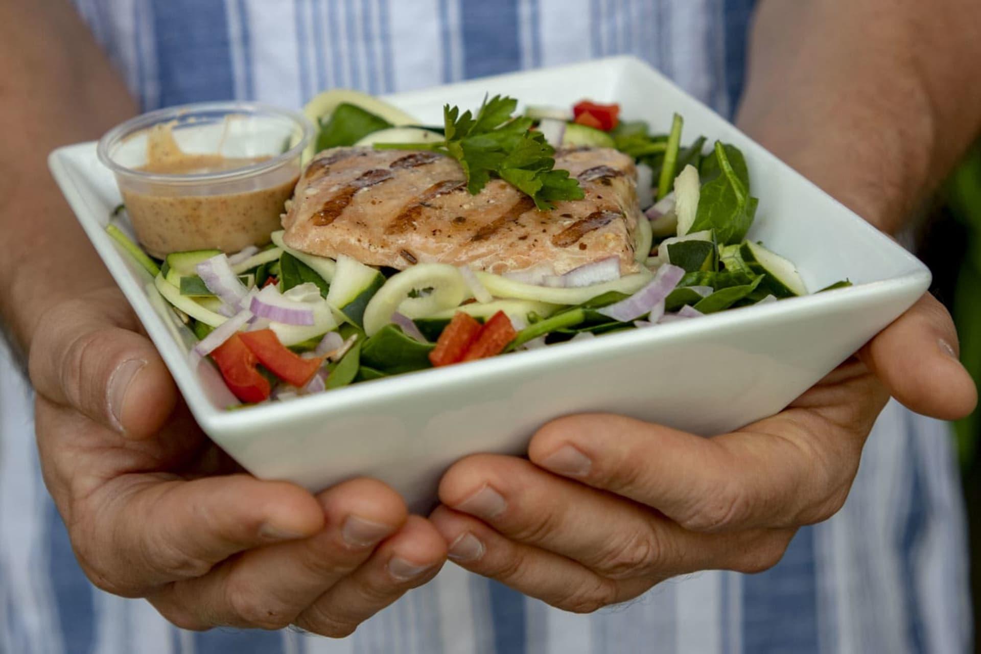 holding salad
