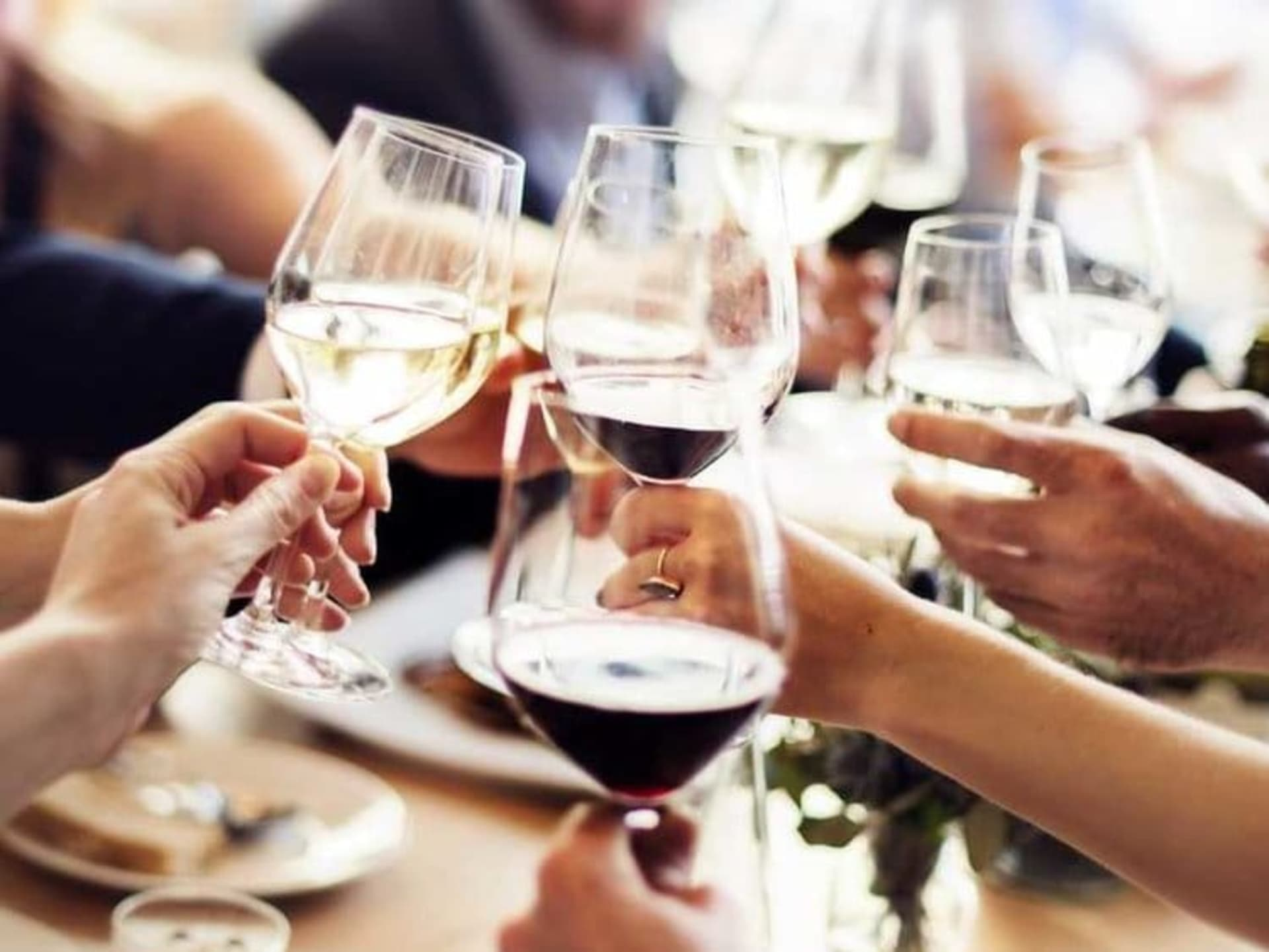 group of people with wine in hands
