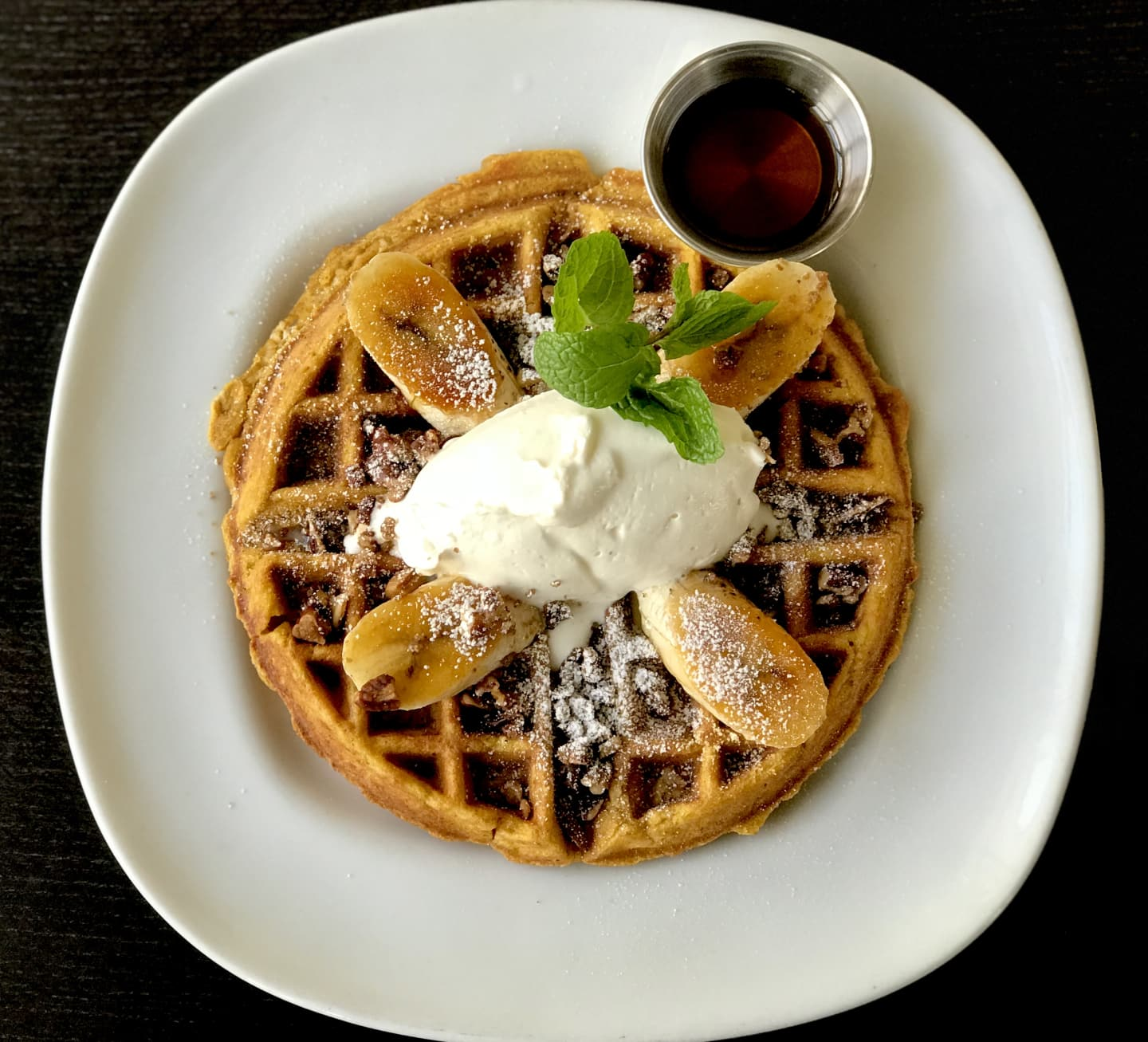 Pumpkin Oatmeal Waffle w/ Caramelized Bananas,Candied Pecans & Real Maple Syrup