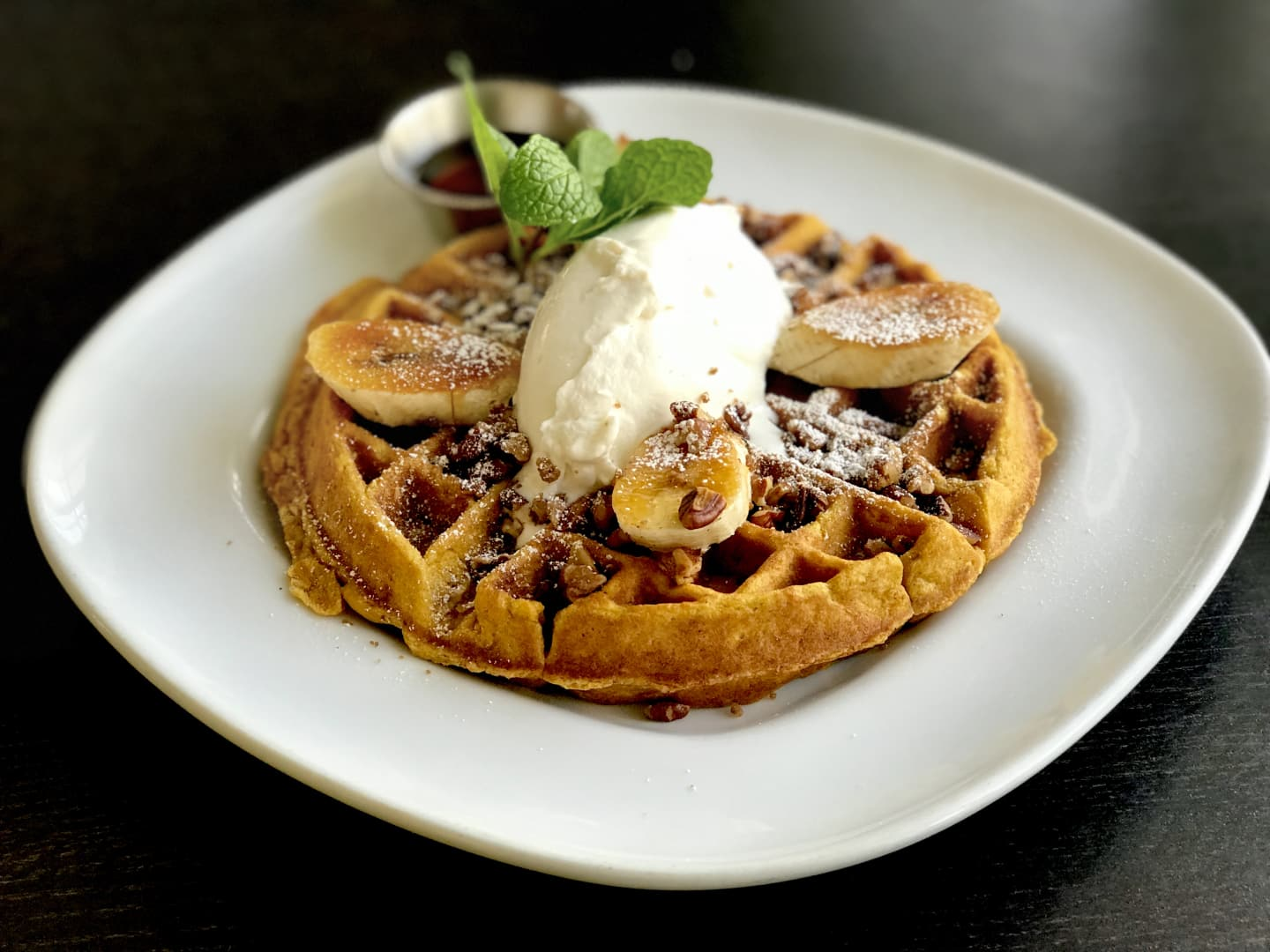 Pumpkin Oatmeal Waffle w/ Caramelized Bananas, Candied Pecans & Real Maple Syrup