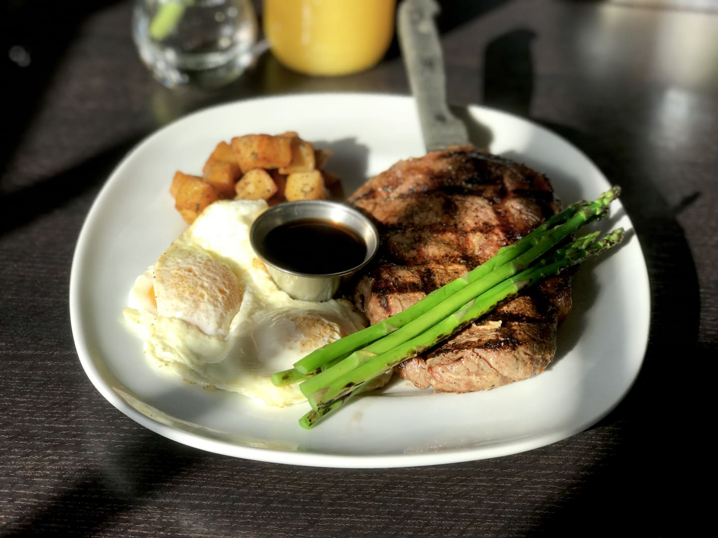 CowboyRib Eye Steak and Eggs w/ 2 Eggs Any Style, Grilled Asparagus, RedPotatoes&Worcestershire Sauce