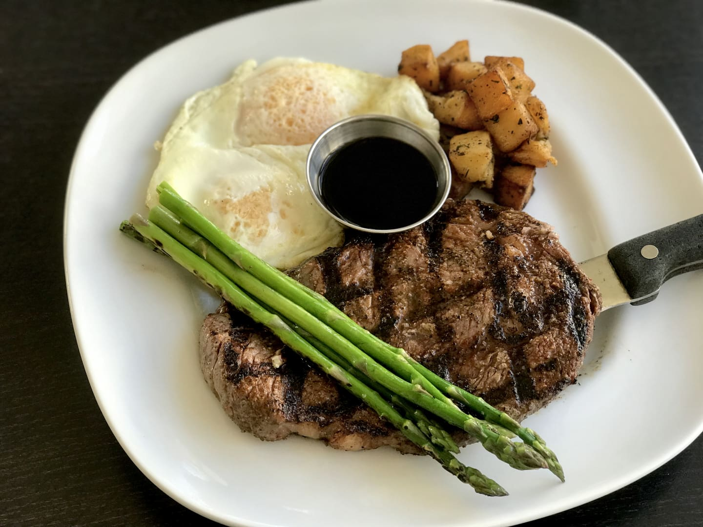 Cowboy Rib Eye Steak and Eggs w/ 2 Eggs Any Style, Grilled Asparagus, Red Potatoes & Worcestershire Sauce