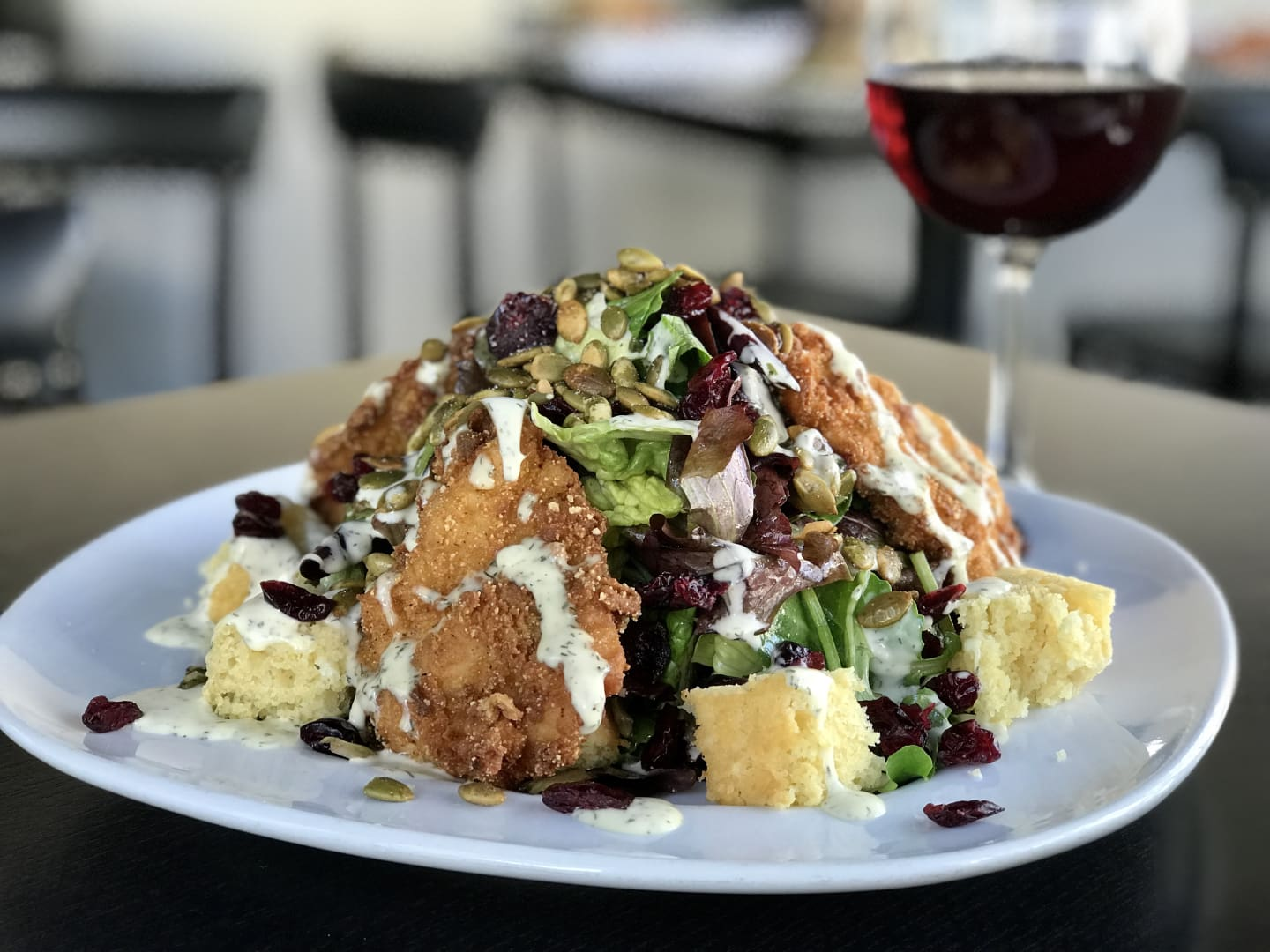 Fried Chicken Salad w/ Cornbread, Dried Cranberries, Pumpkin Seeds & Herb Buttermilk Dressing