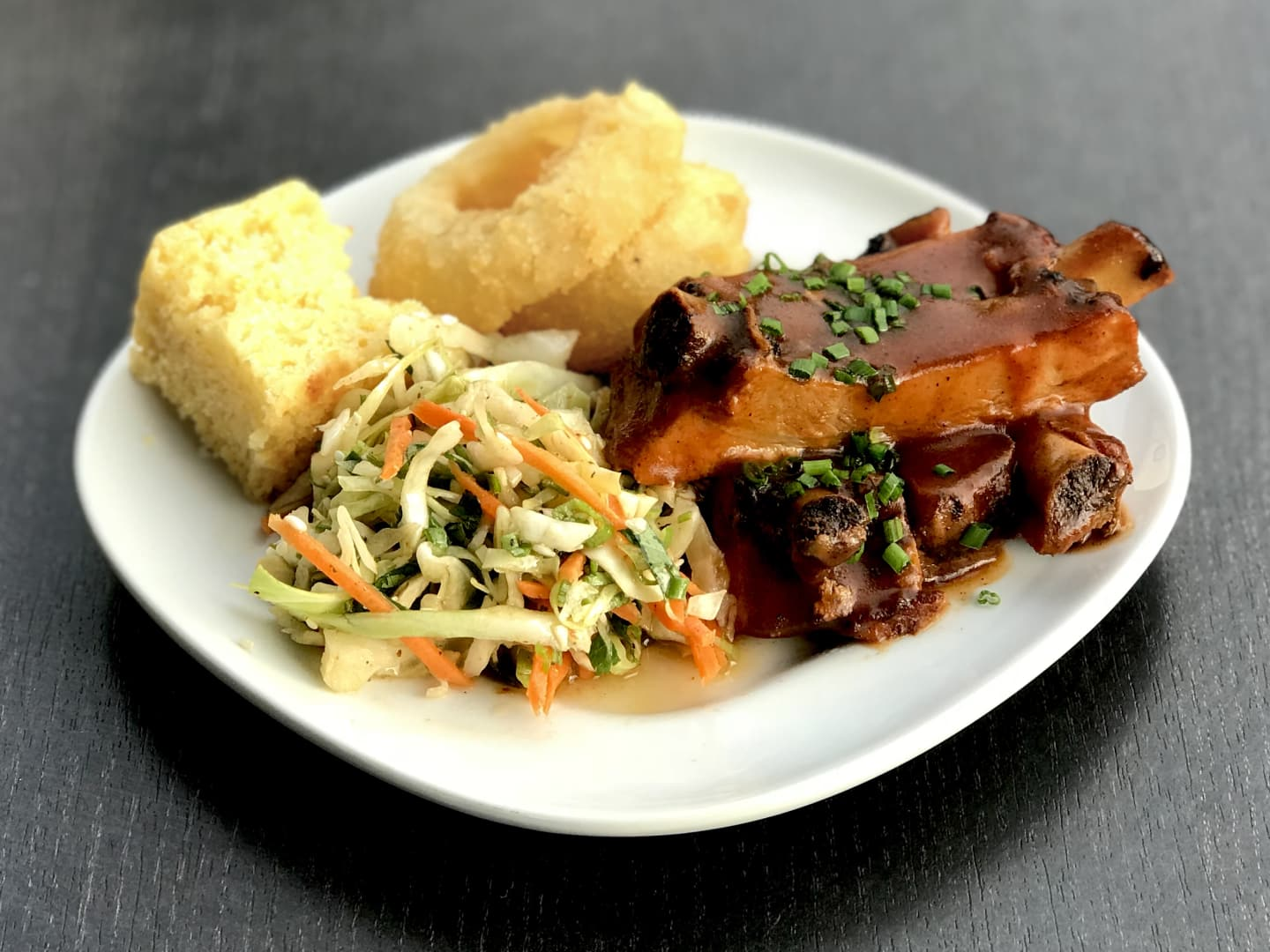 Bloody Mary Braised Ribs w/ Fried Onions, Cornbread & Sesame Peanut Coleslaw