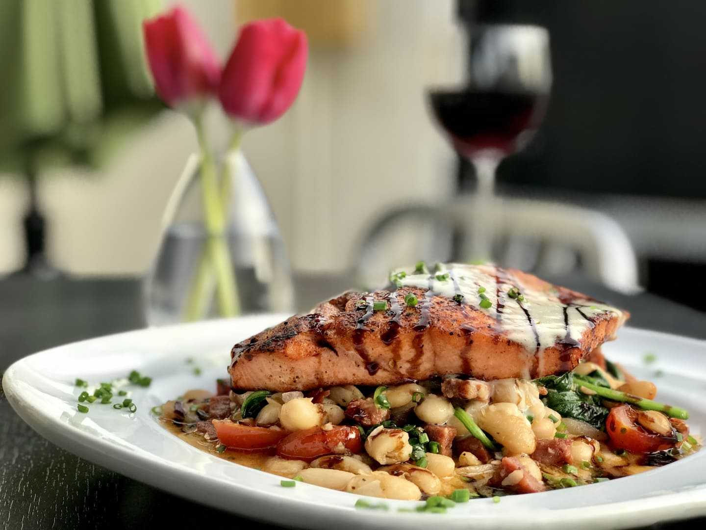 Blackened Molasses Wild Salmon w/ Spinach, White Bean, Cherry Tomato & Andouille Sausage Sauté