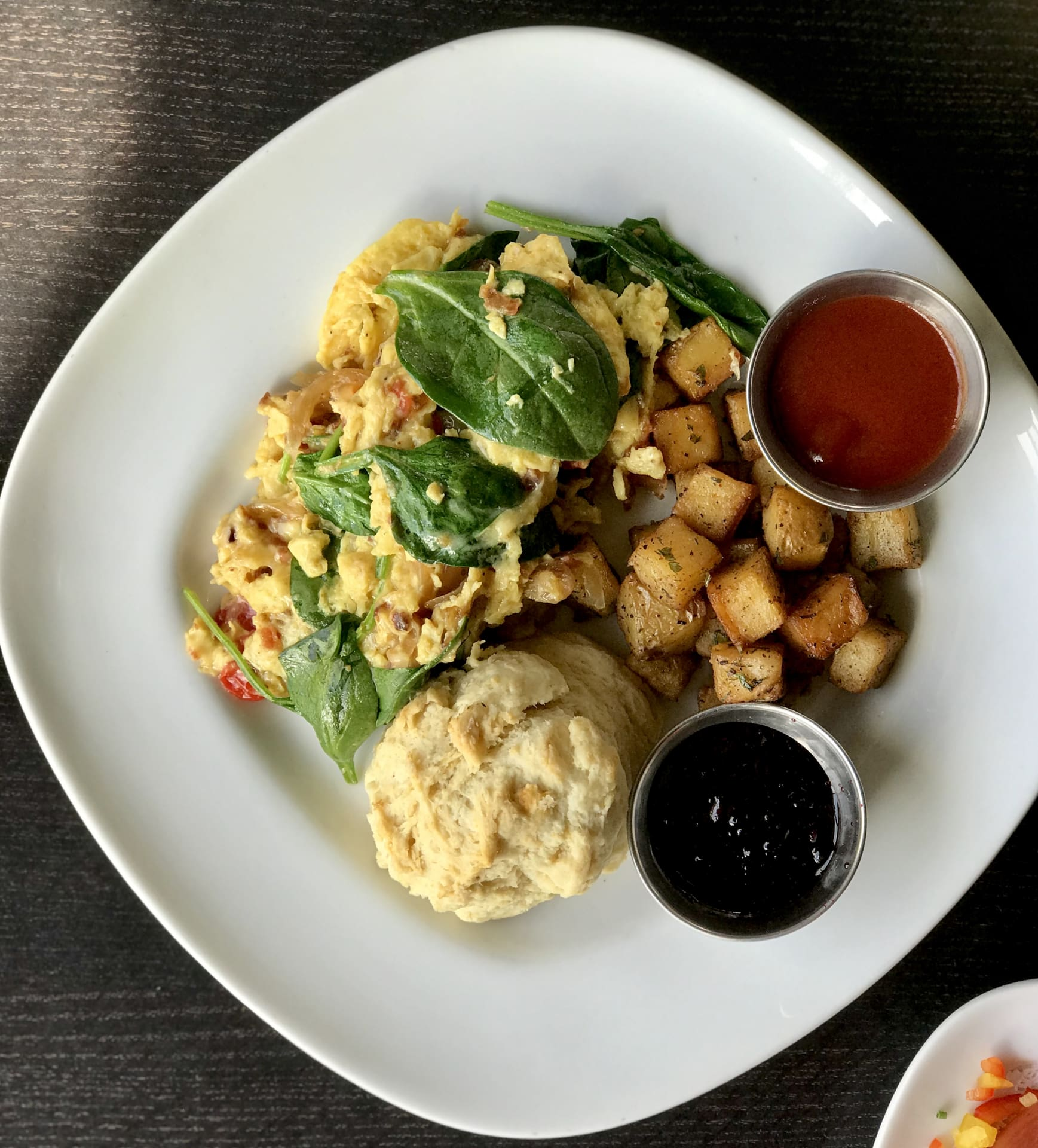Smoked Bacon, Spinach, Caramelized Onion, Tomato  & Gouda Scramble w/ House Potatoes