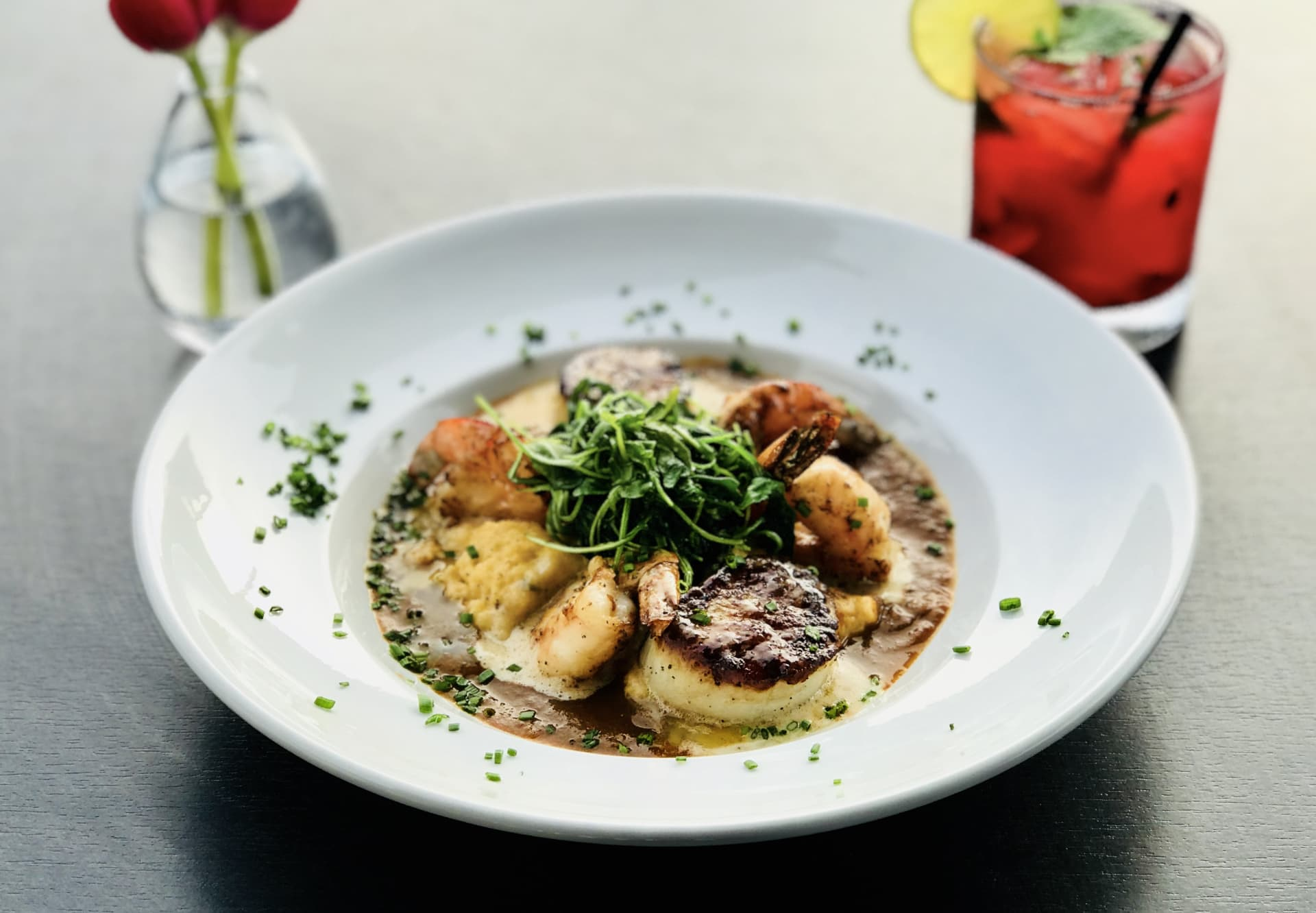 Southern Shrimp & Diver Scallop w/ Cheddar Jalapeno Grits, Sauteed Arugula & Lobster Gumbo Sauce
