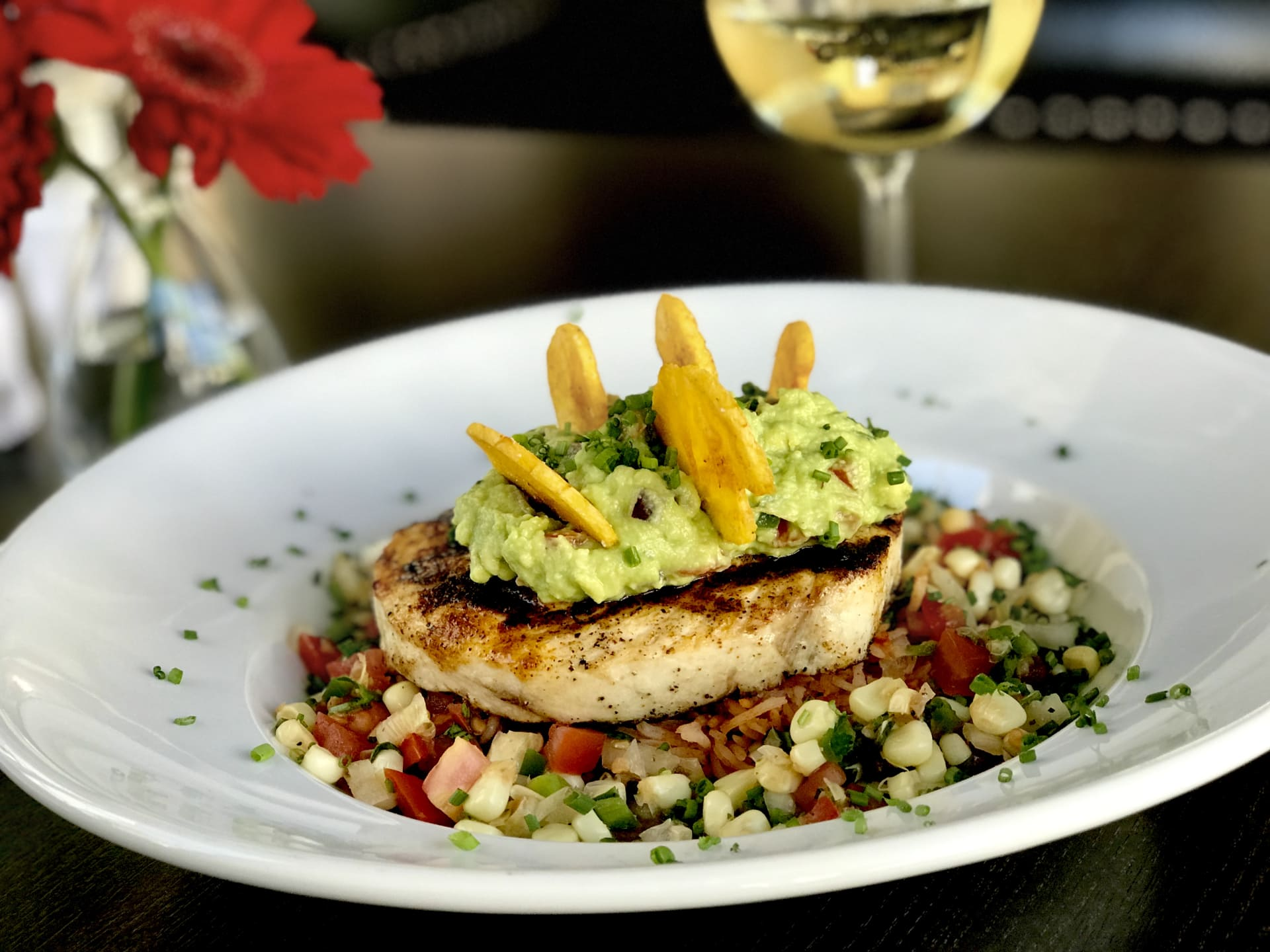 Grilled Wild Swordfish w/ Chili Style Black Bean Puree, Red Rice, Avocado Salsa & Fried Plantains