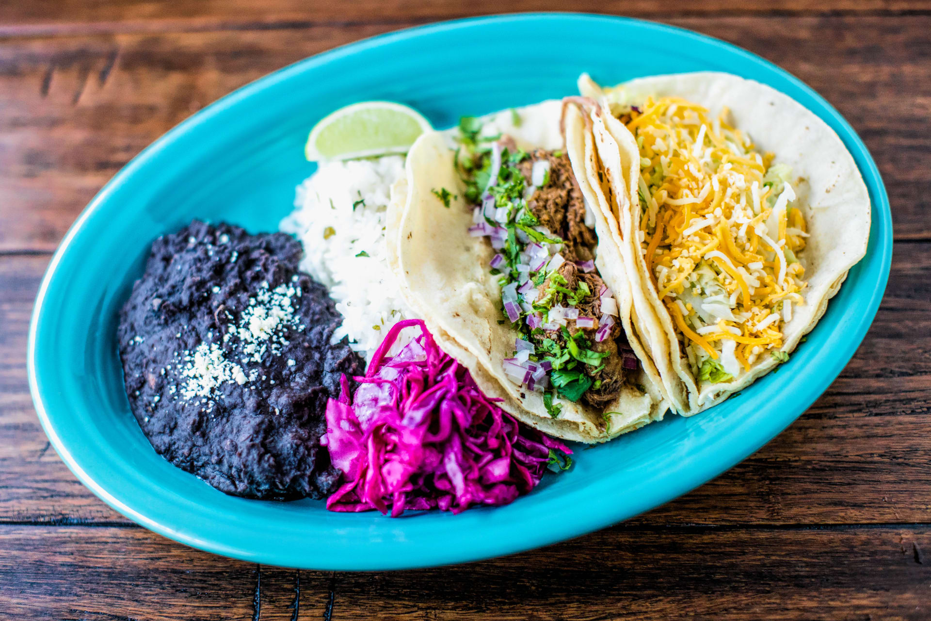 DAILY LUNCH SPECIAL 2 TACOS, RICE & BEANS