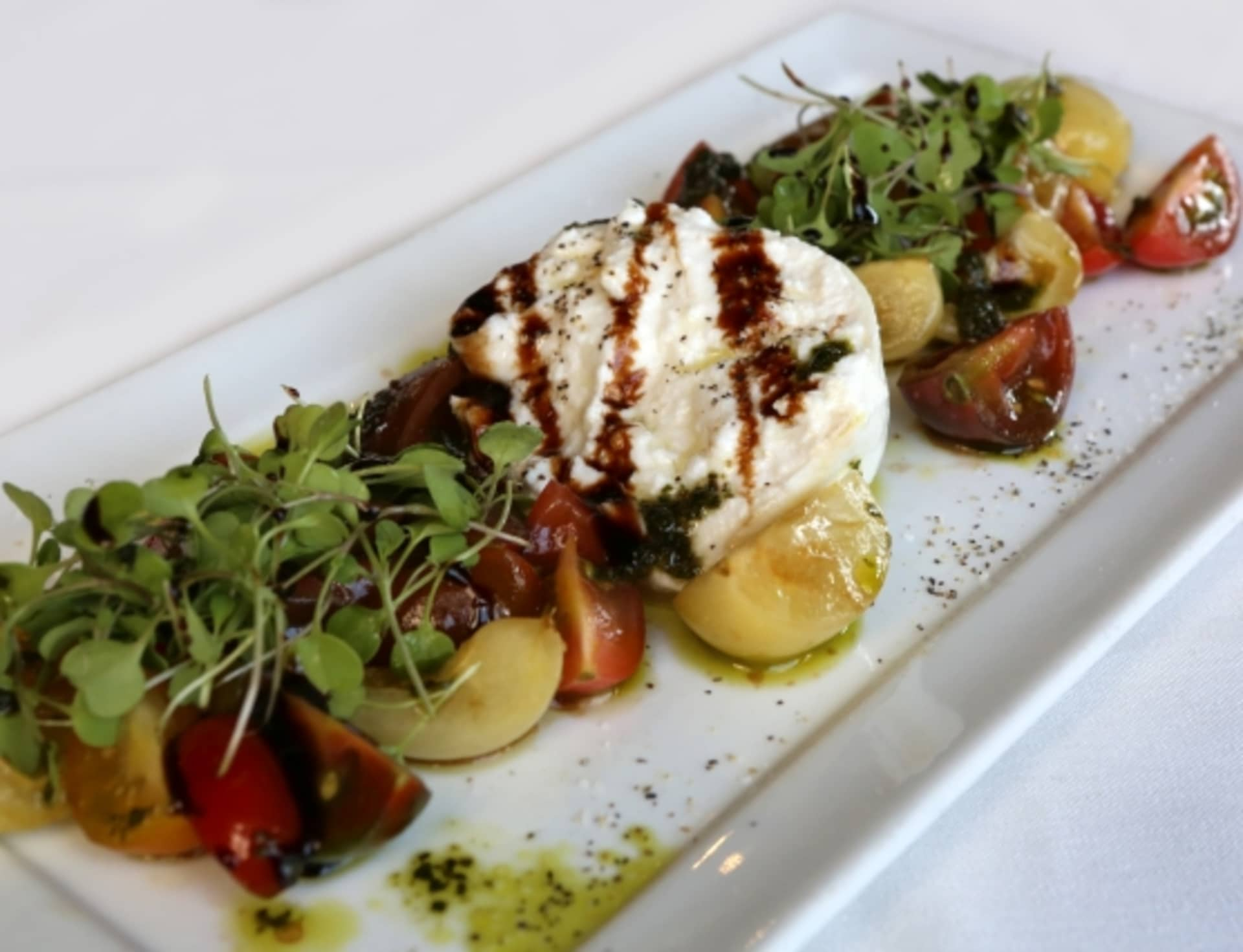 BURRATA & ORGANIC HEIRLOOM TOMATO SALAD