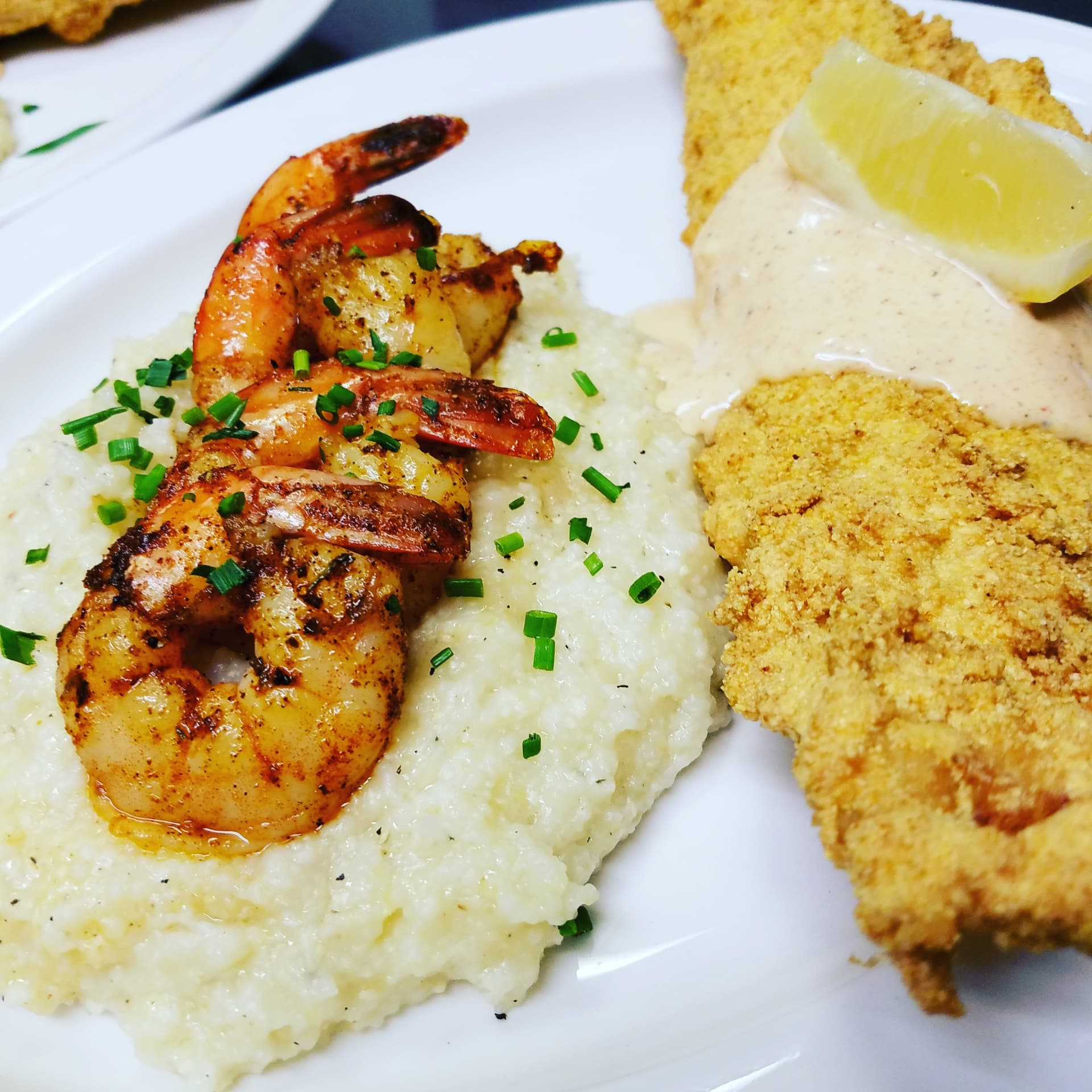 Cornmeal dipped Haddock with Shrimp and Cheesy Grits