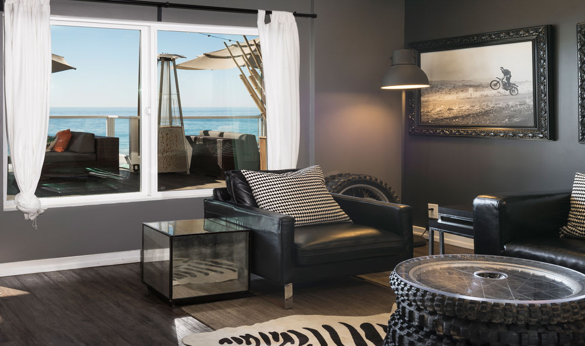 photo of fox room with leather chair and beach view