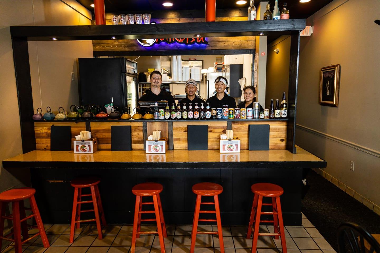 staff behind bar