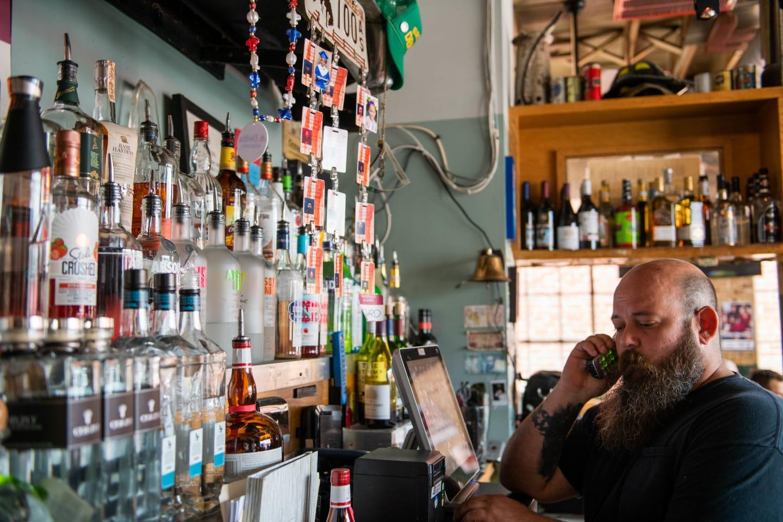 bartender on phone