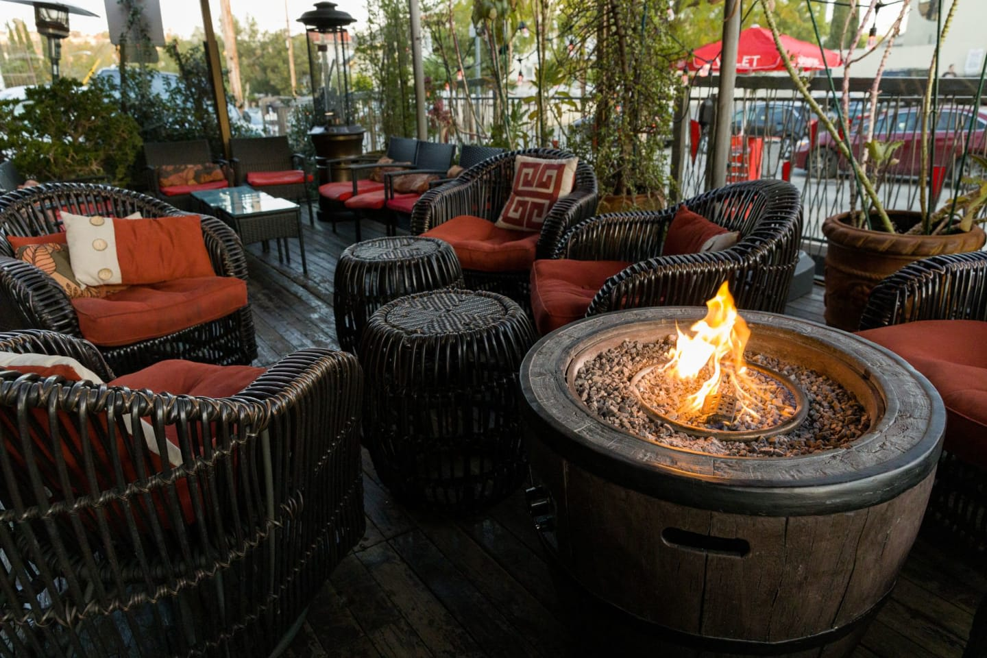 Patio with chairs and a fire pit