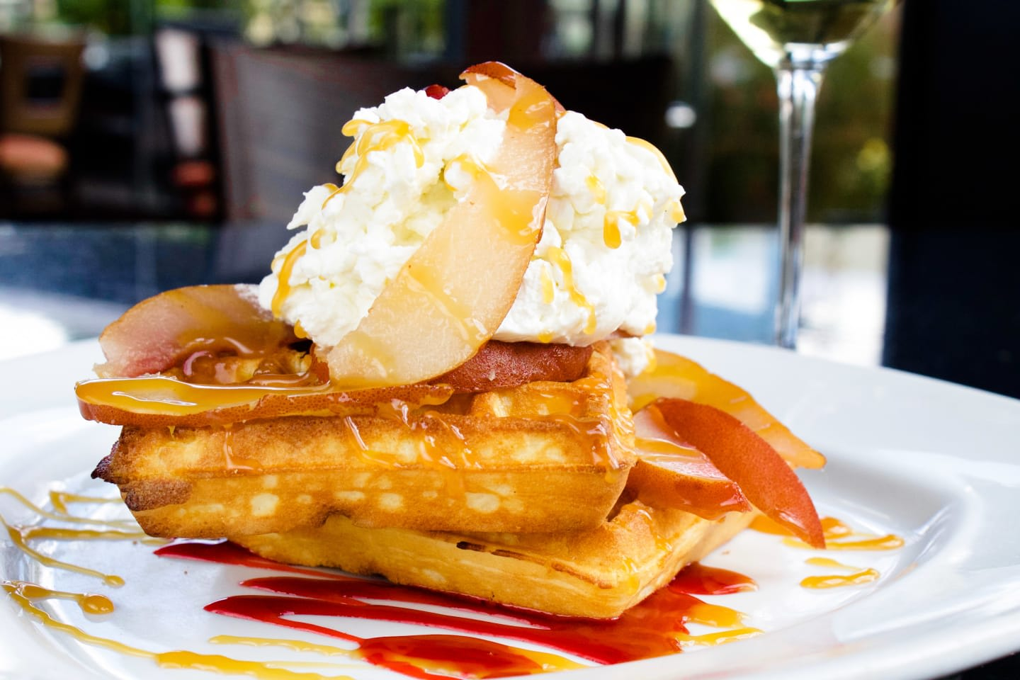 Poached Pear Waffle with, berry compote and creme fraiche.