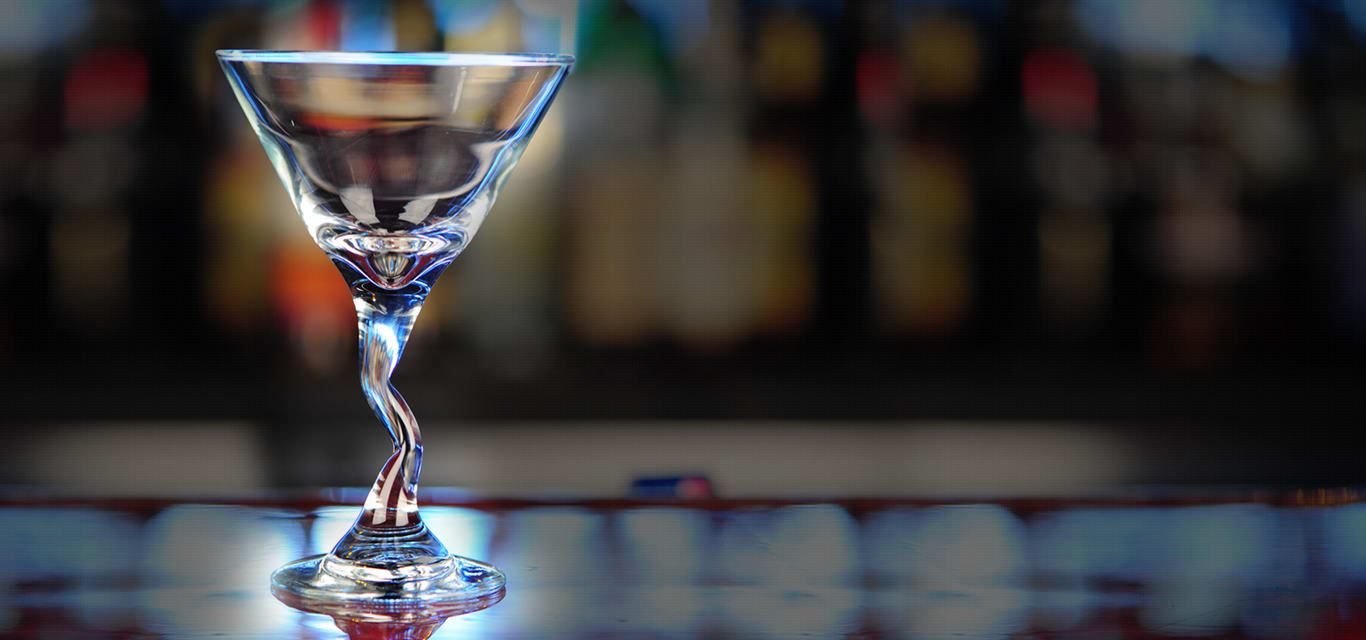 martini glass on bar