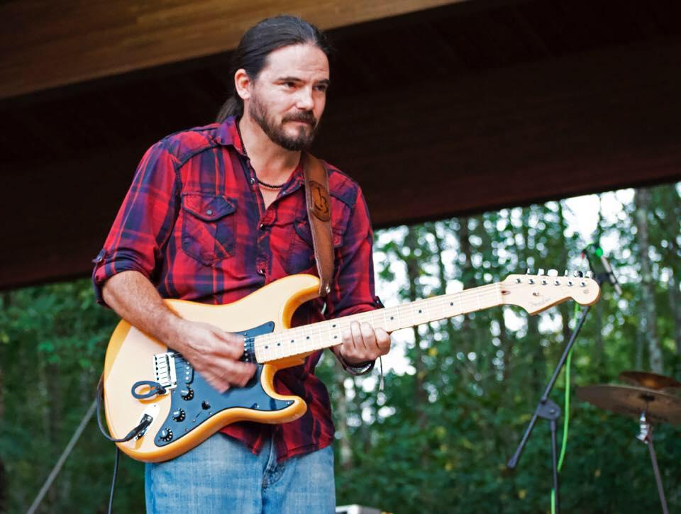 Chip Jones playing a guitar