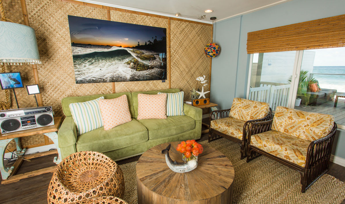 photo of green couch and chairs in living room of xs bungalow