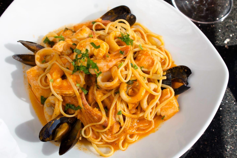 Seafood Linguini Linguini pasta with calamari, salmon, shrimp, halibut and mussels.