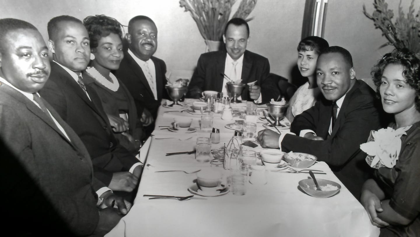 Rev. Fred Bennett, Mr. Isaac Farris, Sr., Mrs. Christine King Farris, Rev. Ralph D. Abernathy, Dr. Roy C. Bell, Mrs. Clarice Wyatt Bell, Dr. Martin Luther King, Jr., Mrs. Coretta Scott King; Pascal's Restaurant, Hunter St., Atlanta, GA. ~1962 — Photo via Dr. Clarice Bell on Flickr