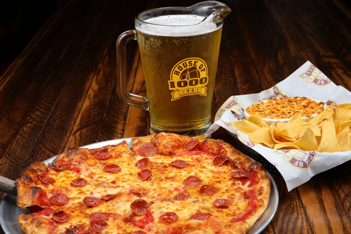 pizza with beer pitcher