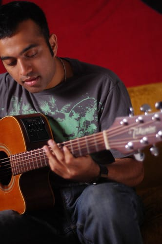 Shreeps Zala playing a guitar