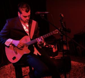 Michael Zaib playing a guitar