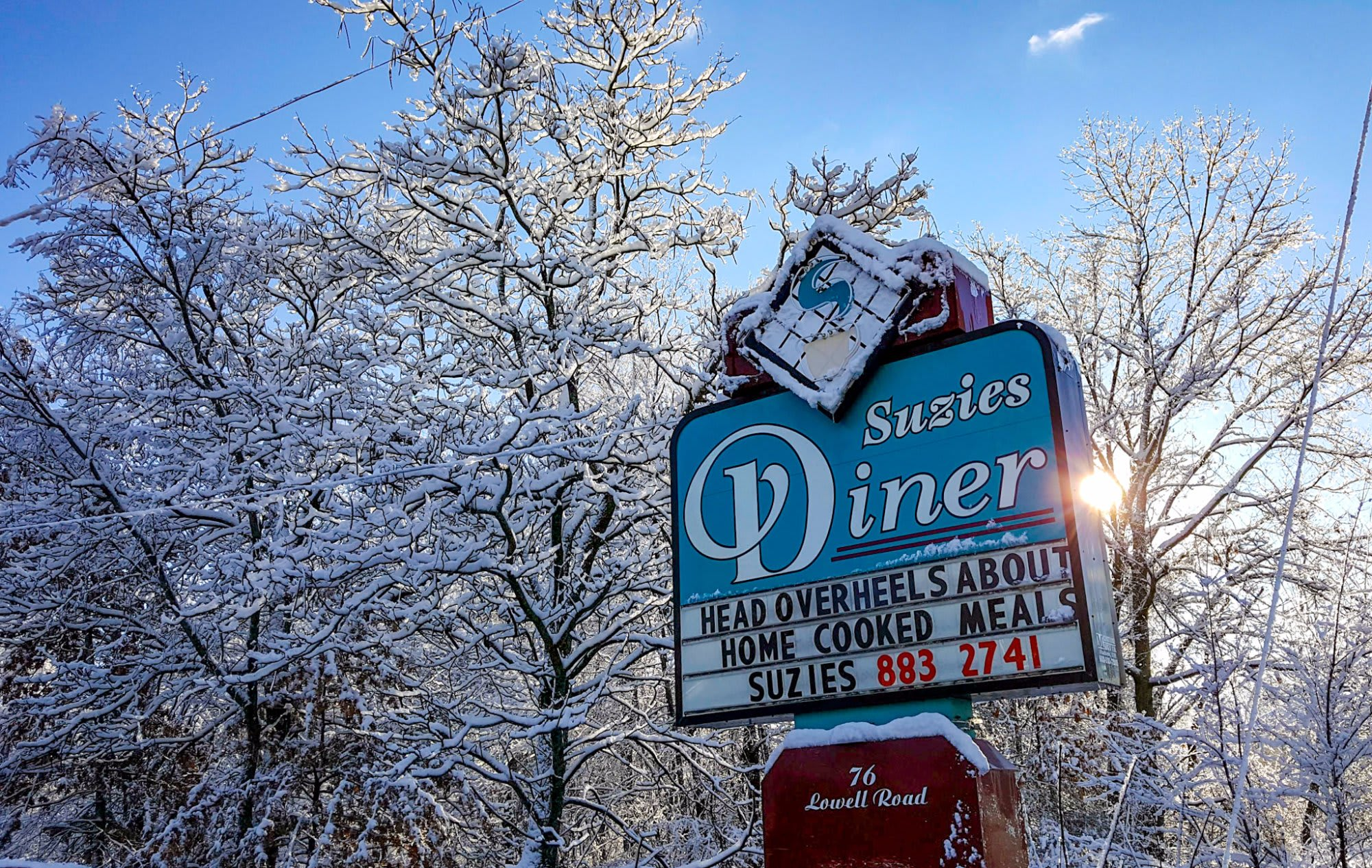 Suzie's Diner sign in the snow