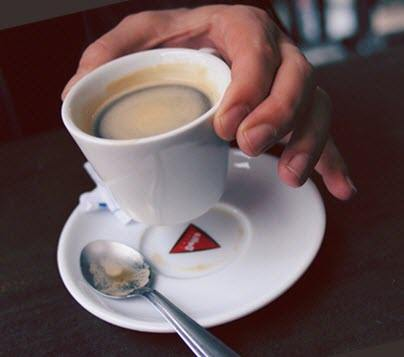 Male hand hold cup of coffee