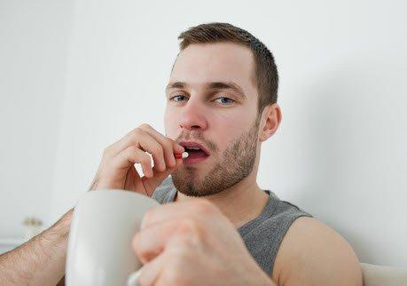 The man takes a semen volume enhancer pill