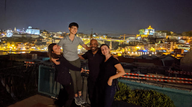 Group photo overlooking the city after dinner