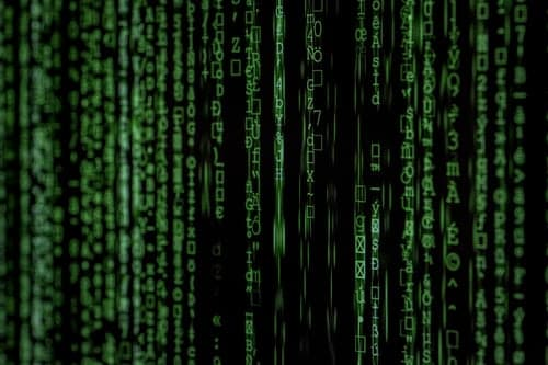 A picture of the famous scrolling code scene from the film The Matrix - many overlapping columns, neverending green streams, of alien-looking characters.