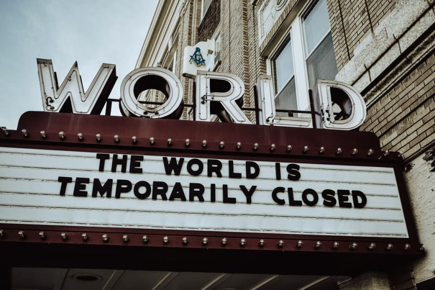 a sign saying the world is closed