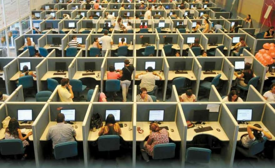 A cubicle farm of customer service agents.